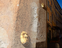 Face on a Roman Wall (stephenweir) Tags: goldeneye goldenface faceonthewall romanface maskonwall italian artonthewall rome ancientrome oldrome italy mural sculpture realism mask