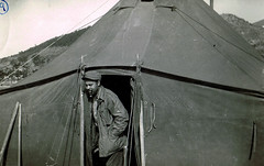 Sergeant Hall (Midnight Believer) Tags: koreanwar korea armytent tent unitedstatesarmy soldier military uniform retro candid pipe pipesmoker smoking 1950s warzone blackman africanamerican