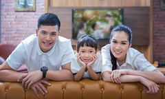 happy young family wathching flat tv (anekphoto) Tags: family windows portrait people woman man male love home girl television smiling kids female vintage movie mom relax asian fun thailand happy living tv asia dad sitting technology child flat room father watching joy mother screen livingroom couch indoors sofa together thai laugh remote casual leisure plasma lcd relaxed channel