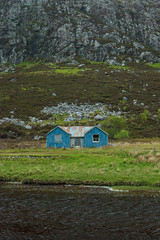 blue shack (Francis Mansell) Tags: blue house building abandoned river scotland highlands outdoor hill shack scottishhighlands gneiss lewisiangneiss gruinardriver