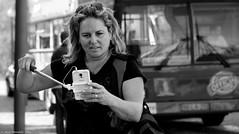 The hidden danger. (Neil. Moralee) Tags: neilmoralee neilmoraleenikond7100 selfie delfy self portrait distracted bus coach woman girl phone picture photograph risk stick black white bw blackandwhite death danger injury injured accident salamanca spain outdoor people depth field blonde blond beauty atractive samsung smart hidden neil moralee nikon d7100 street candid