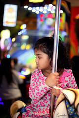 Carousel Ride (s_harish611) Tags: kids portraits canon 5d 50mm lights carousel ride cute color