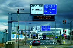 Heading Northside (Owen J Fitzpatrick) Tags: ojf people photography nikon fitzpatrick owen j joe pretty pavement chasing d3100 ireland editorial use only ojfitzpatrick eire dublin republic city tamron toll tolled tunnel m50 graphic sifn signage markings port left overcast traffic auto car vehicle road cloud blue