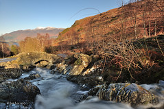 Light Of A New Year (jeanette_lea) Tags: ashness bridge the lake district cumbria water rocks stones trees fells light snow shadows sky
