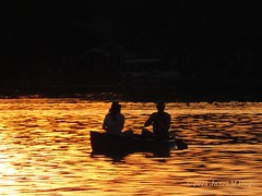 On Golden Canoe (JKissnHug) Tags: sunset water silhouette gold golden boat michigan canoe commercetwp cooleylake