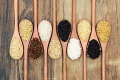 Different types of rice (Ale Berger) Tags: wood light red food black detail macro yellow breakfast studio idea healthy nikon asia raw rice natural background low grain cook indoor organic concept diet woodenspoon basmati d600