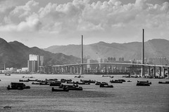 Stonecutter bridge and Victoria Harbour (Tommaso Meli) Tags: china blackandwhite hongkong asia harbour cina reportage victoriaharbour stonecutter hongkongbay tommasomeli baiadihongkong