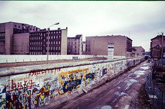 In the shadow of the wall (Vibrimage) Tags: 1987 americansector berlinwall dmz eastberlin easterneurope freedo graffiti westberlin barbedwire concrete partition scaaned scanned separation watchtower ironcurtain freedom