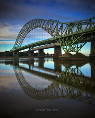 Mirror Images (Grains of Rice) Tags: runcorn runcornbridge mersey rivermersey river reflection water iphone iphonography hdr snapseed