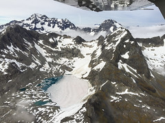 Glacier and Lake, NZ (stephenk1977) Tags: newzealand queenstown milfordsound scenic flights aerial plane ga8airvan alpine mountain view iphone6 glacier lake snow ice southern alps nz