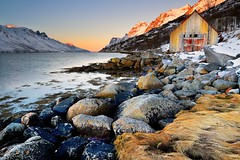 Norwegian Sunrise (Tony Armstrong-Sly) Tags: norway fiord ersfjordbotn tromso sea landscape seascape seaweed coast sky sunrise norwegiansea scandinavia oldbuilding rocks beach snow winter nature