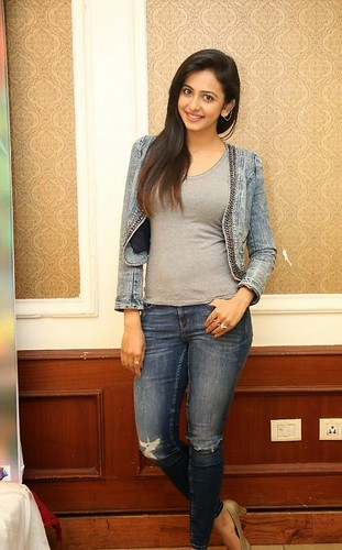 Actress Rakul Preet Singh Live Pics In Open Hairstyle Torn Jeans