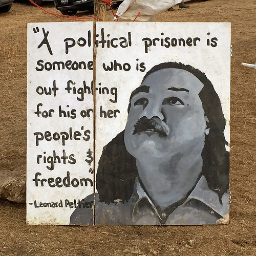 From flickr.com: Leonard Peltier, political prisoner since 1975. Now sick, dying and refused family visits. {MID-134651}