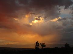 Second Sun (stvpak) Tags: sunset sunrise clouds thunderstorm thunderhead outdoors orange colors reflect reflection