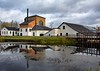 Stromsberg Works (sussexscorpio) Tags: strömbergs upplands sweden strömbergsworks mill rivertämnarån river tämnarån iron works reflection canon canon60d chimney whitemill museum industry scandinavia europe travel water architecture outdoor building