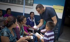 Sailor explains prescription procedures to a host nation patient at the Continuing Promise 2017.