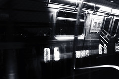 A Reflective Ride (VIProduction) Tags: eye reflection travel traveling nyc ny outdoors photography photographer pointofview light graphicdesign graphic flickr day canon canon6d canonphotos view visual newyorkcity newyork noiretblanc blackandwhite blackwhite noir bw subway train trains february digital night