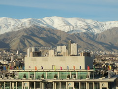 Tehran clear skyline and snowed mountains, Iran (Germán Vogel) Tags: asia westasia middleeast middleeastculture muslim muslimculture centralasia iran iranian travel traveldestinations traveltourism tourism touristattractions tehran capitalcity city cityscape urban urbanlandscape concrete architecture contemporaryarchitecture modern building mountain snow mountainrange alborz mountainside skyline clearsky milad miladtower