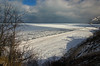 Patches of Bright Sun (Tom Gill.) Tags: lake lakemichigan greatlakes indianadunesnationallakeshore indiana dune winter frozen ice
