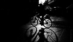 Into the unkown. (Mister G.C.) Tags: blackandwhite bw ricoh ricohgr streetphotography urbanphotography candid street shot image photograph people monochrome town city silhouette shadow bicycle pushbike bike cycalist zonefocus zonefocusing snapfocus pointshoot mistergc schwarzweiss strassenfotografie hannover germany niedersachsen lowersaxony deutschland europe
