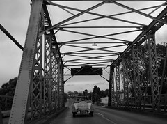 old car old bridge (minitanker) Tags: vintage car black white bridge steel old wanganui nz new zealand structure spanning river