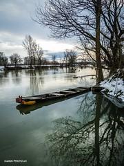Boat on high water (malioli) Tags: river water boat tree riverside riverbank snow winter reflection pentax woodenboat korana karlovac croatia hrvatska europe