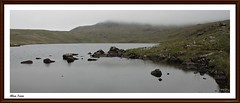 Blea-tarn. (stu.bloggs..Dont do Sundays) Tags: summer cloud mountains cold water weather june canon landscape landscapes rocks moody view cloudy lakedistrict foliage cumbria fells bleak grasses marsh 1855mm elevation tarn lakeland atmospheric moorland bleatarn microclimate rockyoutcrops