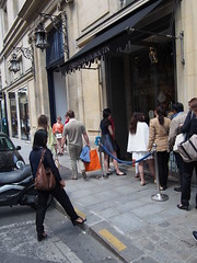 "Kew of chinese tourist outside the luxury boutique ""Christian Louboutin"". Also called red bottoms!"