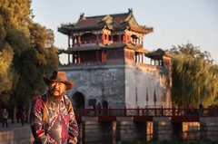 China: Standing Still #1 (laskaproject) Tags: china old travel bridge sunset portrait sun lake man architecture ancient asia beijing willow local summerpalace ornate royalty