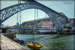 Yellow Rabelo Boat (lzvphotography) Tags: old city bridge portugal yellow architecture canon river boat europe porto transportation douro hdr 700d luisazevedophotography lzvphotography