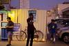 IMG_1103 (fadlshrief) Tags: street photography candid streetphotography doha qatar alsadd workers blue collar nighttime men sidewalk talking phones smartphones distraction
