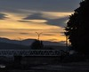 Sunset at the Ferry Terminal (Tynan Phillips) Tags: nikon nikond90 d90 dslr denmanisland bc britishcolumbia canada canadian tree trees plants sunset sunlight silhouettes silhouette silhouetted forest sky clouds shadow nature yellow beach sea