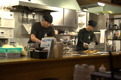 Chef preparing Okonomiyaki