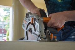 274/366 - New floor (Spannarama) Tags: 366 september circularsaw saw cutting powertool workbench workmate chipboard floorboard hands diy