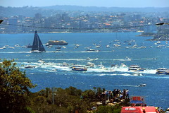 """DSCF1003-b (later more naturally colored version edit) Start of the """"Sydney to Hobart yacht race"""" 2016 """"Perpetual Loyal"""" nearing """"The Head(land)s"""" (Watsons bay - East Manly) at the mouth of Sydney Harbour to open sea with a flotilla of spectator craft. (nicephotog) Tags: sydney hobart harbour yacht race harbor flotilla sailing sea ocean craft boxing day december 26th city watsons bay gap vaucluse heads lookout spectators competitors ferry boat catamaran cliff ledge coastline skyline shoreline crowd view start perpetual loyal water surf waves"""