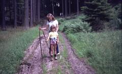 img369 (foundin_a_attic) Tags: europe 35mm slide 1970s parents fashion wood trees green boy girl sticks path trunks shorts white yellow sandles socks