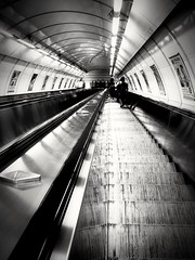 Changing level.. (kallchar) Tags: metro railway metal underground inside stairs steps czechrepublic olympusomdem10 blackandwhite blackwhite art reflection lights shadows escalator subway people transport streetphotography outdoor flickr floors levels travel prague agreatcapture olympus