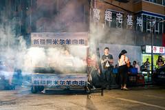 (spatialrhetorics) Tags: china street nightphotography night eyecontact fuji candid smoke streetphotography fujifilm streetphoto nightphoto streetfood changchun dongbei colourstreetphotography guilinlu x100t fujifilmx100t