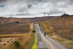 The Lonely Road (Tom Moyer Photography) Tags: california road motorcycles pasture marincounty hay haybales chilenovalley