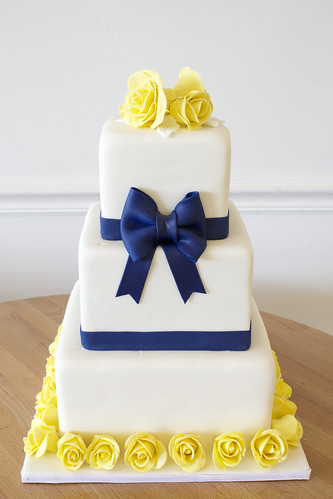 Square Wedding Cake with Navy Bow and Yellow Roses