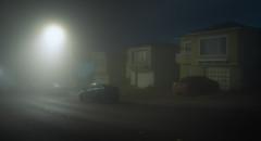 Between Neighbors (C A Soukup) Tags: betweenneighbors cinematic fog night nightphotography noir streetlights suburbia