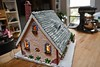 Gingerbread house back with lights. (ineedathis,The older I get the more fun I have....) Tags: storybookhome backside bench mixer window kitchen 2016gingerbreadhouse snowman light atticeyewindow fence stonefence decor slate lightpost stones eave roof royalicing bricks gingerbreadhouse christmas christmastree snow flowers miniature sugarwork gum paste modeling baking nikond750 closeup glitter fairytalecottage