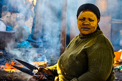 Woman Cooking  A Pig In Langa Township, Capetwon, South Africa (Butch Osborne) Tags: woman cooking pig awesome amazing shanty town capetown langa township adventure fabulous interesting bucketlist africa african colorful scenic culture poor city suburb fire people local