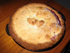 Cherry pie with two hearts on top