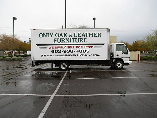 only oak & leather furniture truck