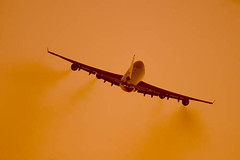 Boeing 747 during flight (Greg Bajor) Tags: orange holiday motion blur speed plane airplane during flying moving airport movement blurry aircraft aviation jets airplanes transport flight jet fast blurred move landing business commercial transportation planes boeing concept airports conceptual gregory runway flights 747 airliner birdlike movingup landings runways bajor movingdown birdlikeimages gregbajor