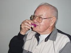 Grandpa enjoying his flower (Fluffy125) Tags: fujiya
