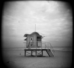 Lifeguard Shack (happygrrl) Tags: ocean bw usa house 120 film beach mediumformat blackwhite holga sand florida miami toycamera lifeguard squareformat lonely shack miamibeach southbeach lifeguardshack