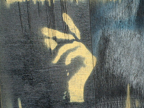 graffiti of a hand, fingers poised to snap