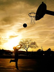 Superstar (taylorkoa22) Tags: sunset shadow orange sun black hot newmexico sports basketball backlight fire kid warm child basket marcus warmth albuquerque son sombra olympus abq marc 300views shooting blaze 300 500 nm 1000 300v 1000v c765 30favs marcgutierrez
